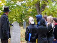 Students touring a cemetery
