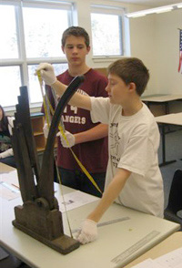 Students measuring an item