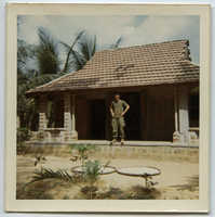 Doug Rawlings on steps of Vietnamese home March 1970