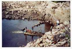 Men draining the Quarry Pond
