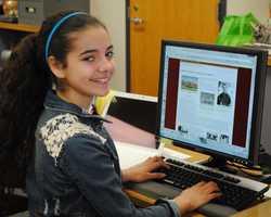 Maine Studies student working on Cohen Exhibit