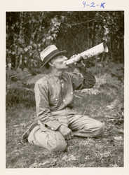 Francis Xavier Tomer, Penobscot, using a moose call, circa 1910