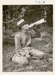 Francis Xavier Tomer, Penobscot, using a moose call, circa 1910