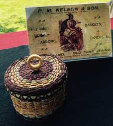 Basket made by Caleb Hoffman, Penobscot, 2015. The business card was one Caleb's third great-grandfather, Peter Nelson, used for his store on Indian Island.