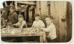Three young cutters in Eastport, 1911 by Lewis Hine