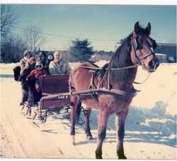Ken Sowles Sharing a Sleigh Ride with Children