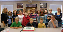 Jessica Kelly (L) and Middle School students